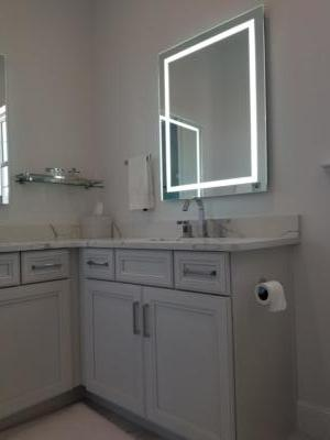 Oceanside Cabinets Bathroom Vanity Cabinet  Melbourne Beach, Florida and lighted mirror