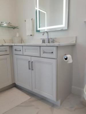 Oceanside Cabinets Bathroom Vanity Cabinet  Melbourne Beach, Florida with lighted mirror side view